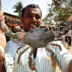 Kandha Malik at market area to sell his crab